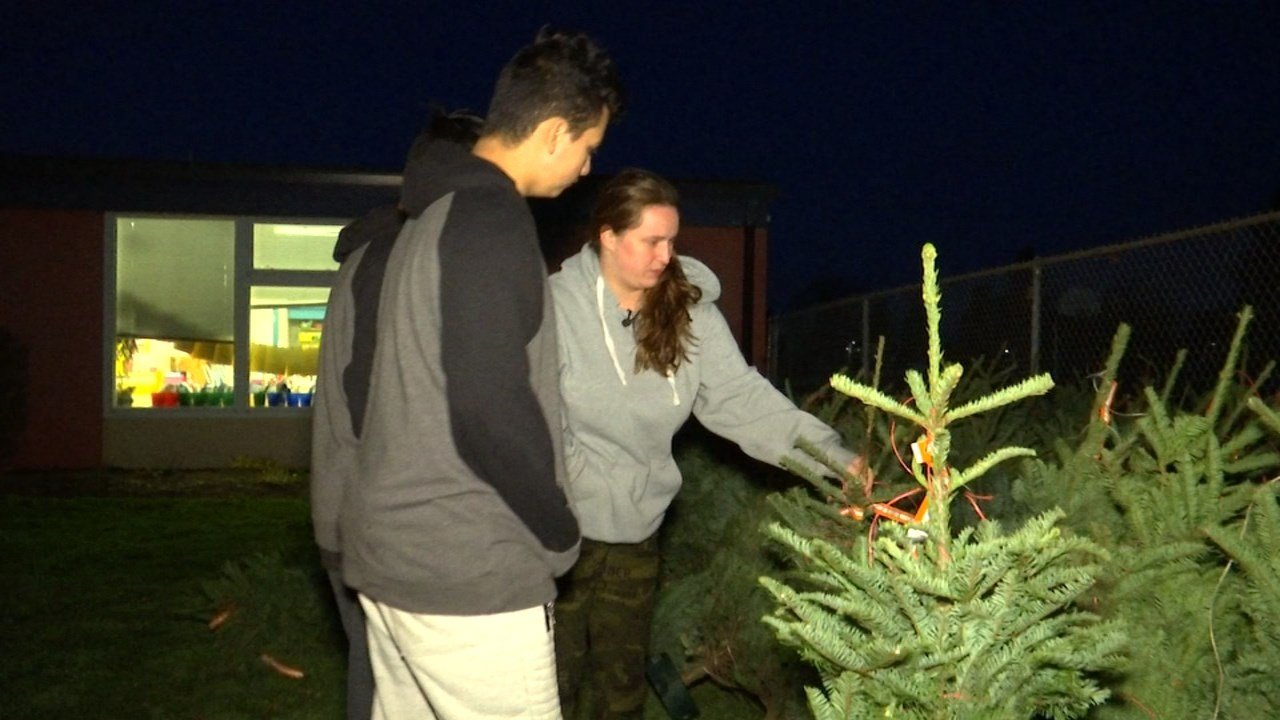 Monica Cordova and her sons picking out a Christmas tree on Tuesday. (KPTV)