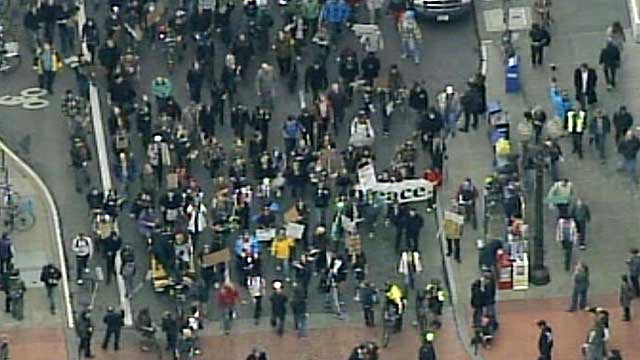 Demonstrators move through the streets of Portland during a march Thursday afternoon.