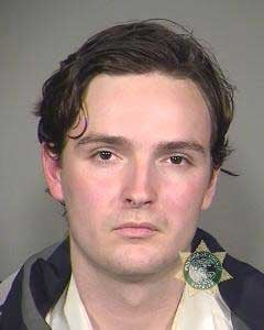 Nolan MacGregor, 21, is accused of spraying graffiti on a Starbucks shop and a Portland police patrol car.