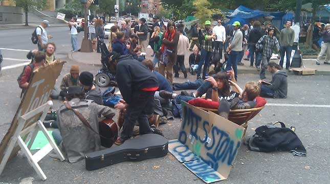 Protesters sat in the middle of a downtown Portland street until police removed them Thursday.