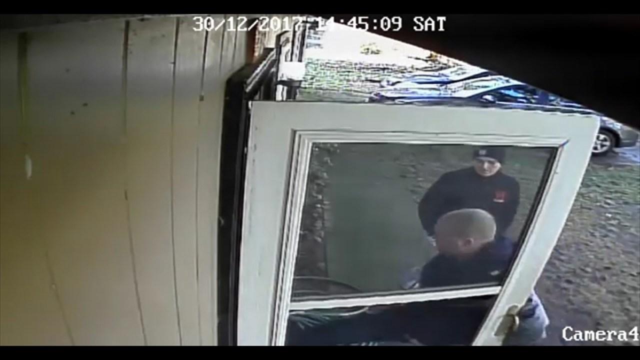 Surveillance image of both of the suspects breaking into Adam Davis' home (Courtesy: Adam Davis)