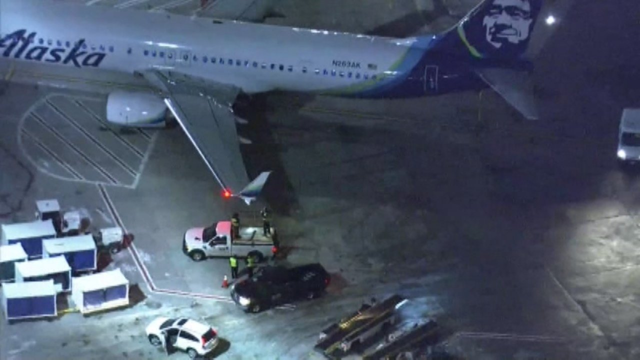 Bound plane strikes truck on Boston taxiway; no injuries