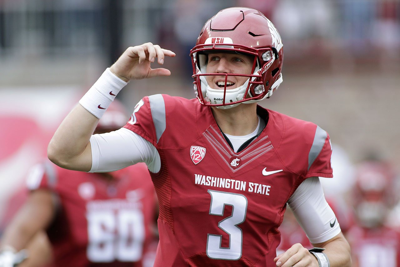 FILE - In this Sept. 17, 2016 file photo, Washington State quarterback Tyler Hilinski (3) runs onto the field with his teammates before an NCAA college football game against Idaho in Pullman, Wash. (AP Photo/Young Kwak, File)