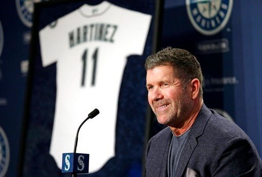 (AP Photo/Elaine Thompson, File). FILE - In this Jan. 24, 2017, file photo, Seattle Mariners former designated hitter Edgar Martinez smiles as he speaks at a news conference announcing the retirement by the team of his jersey number 11, in Seattle.