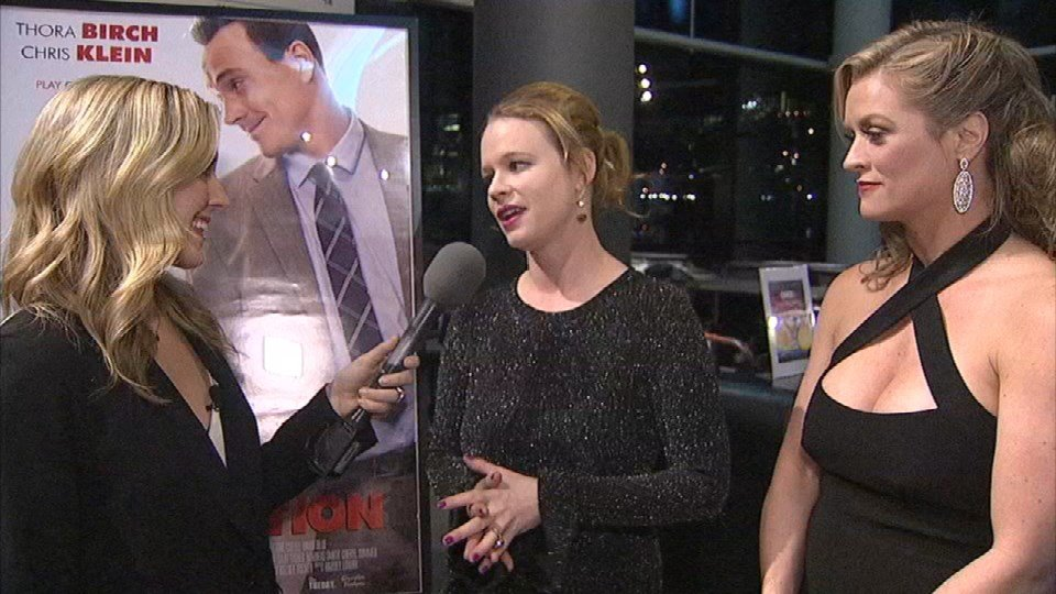 "Actress-producer Thora Birch (center) and writer-producer Kelsey Tucker (right) were among those walking the red carpet for the premiere of the new film ""The Competition"" Friday night at OMSI. (KPTV)"