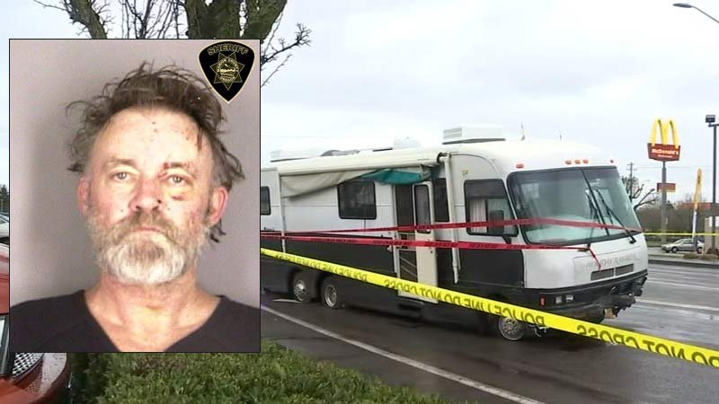 Roy Devoursney is accused of ramming Salem Police Department patrol cars with his RV. (Jail booking photo and scene photo/KPTV)