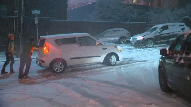 Snow creating slick conditions in NW Portland