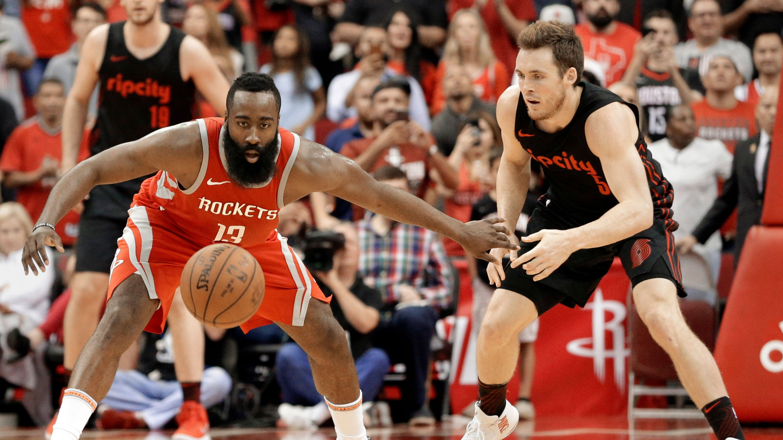 Houston Rockets guard James Harden (13) goes for the ball in front of Portland Trail Blazers guard Pat Connaughton (5) during the second half of an NBA basketball game Thursday, April 5, 2018, in Houston. (AP Photo/Michael Wyke)