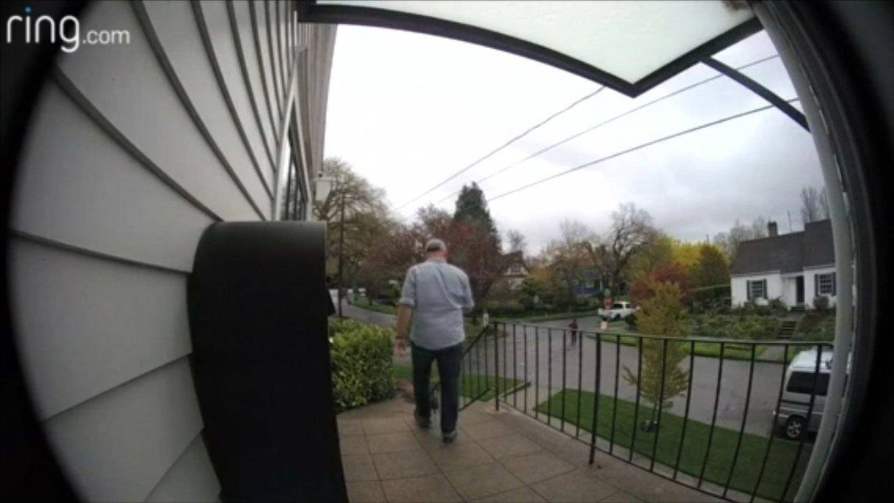 Surveillance image showing Ginger's husband following the suspected thief.
