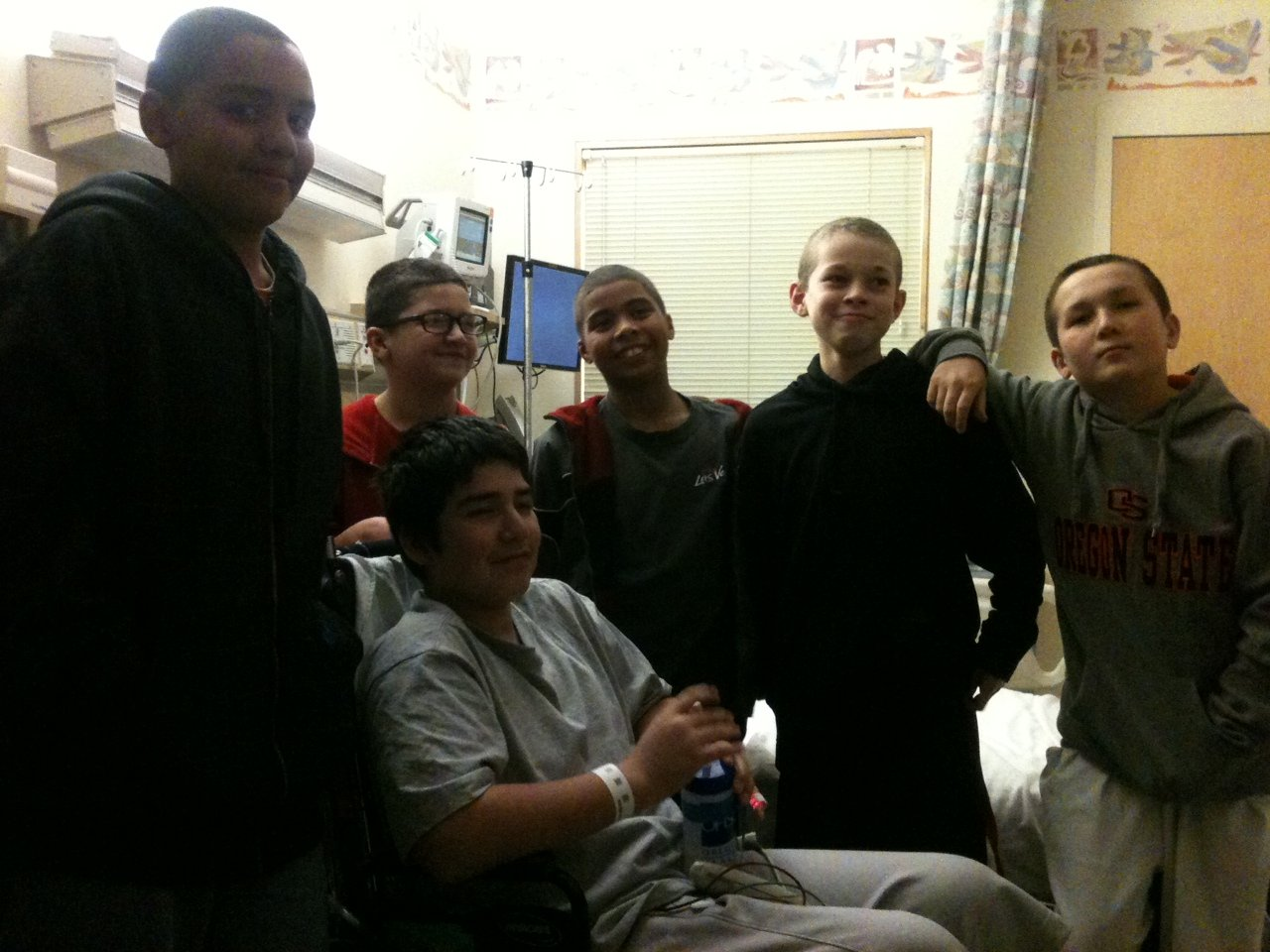 Friends visit Isaac Arzate before his release from the hospital