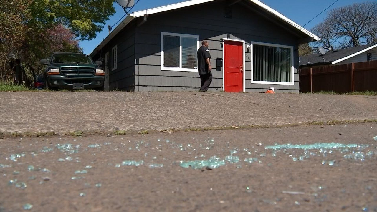 In addition to his dog getting shot Thursday, Johnson said one of his cars was damaged. Glass from a broken window lay scattered across the ground. (KPTV photo).