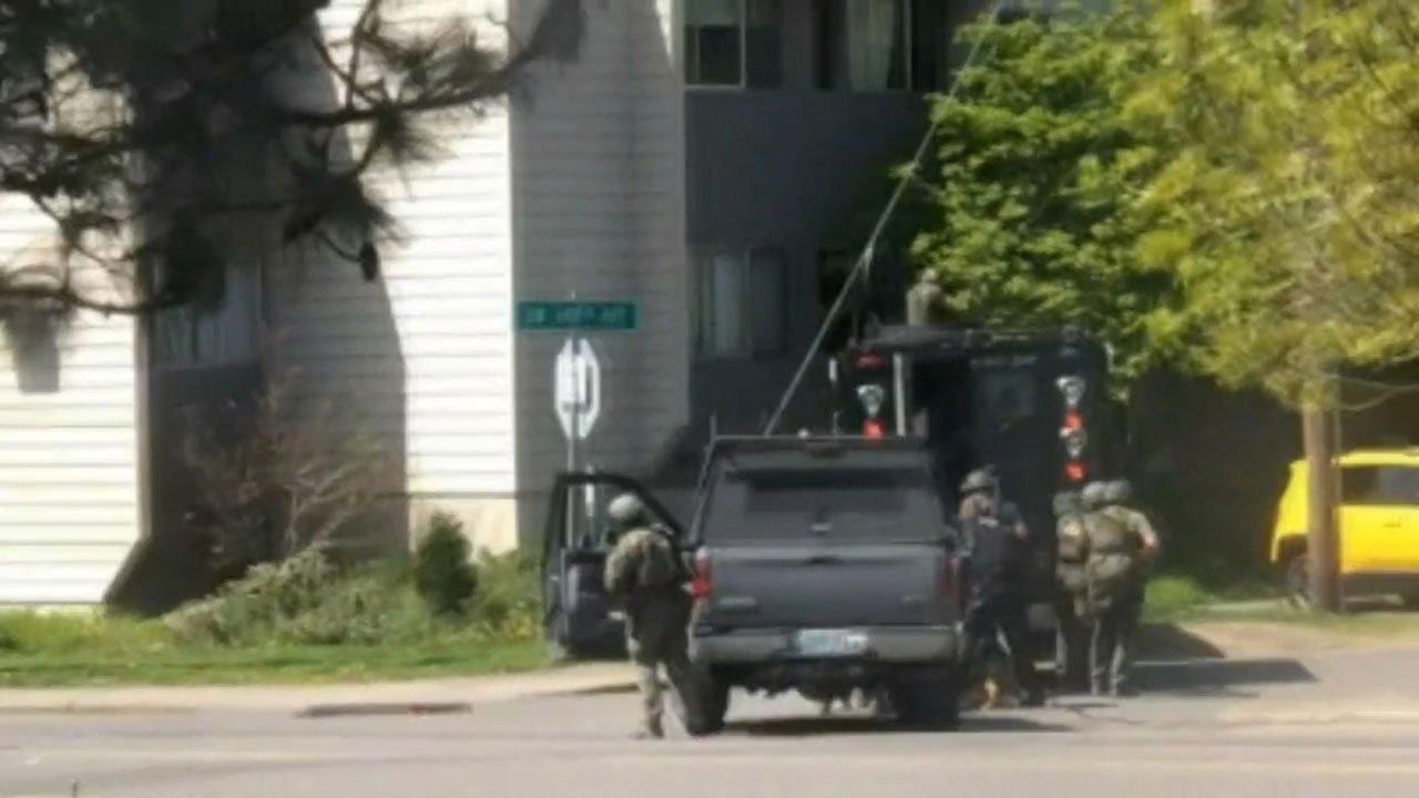 Image from a witness video of the standoff and officer-involved shooting in Beaverton. (KPTV)