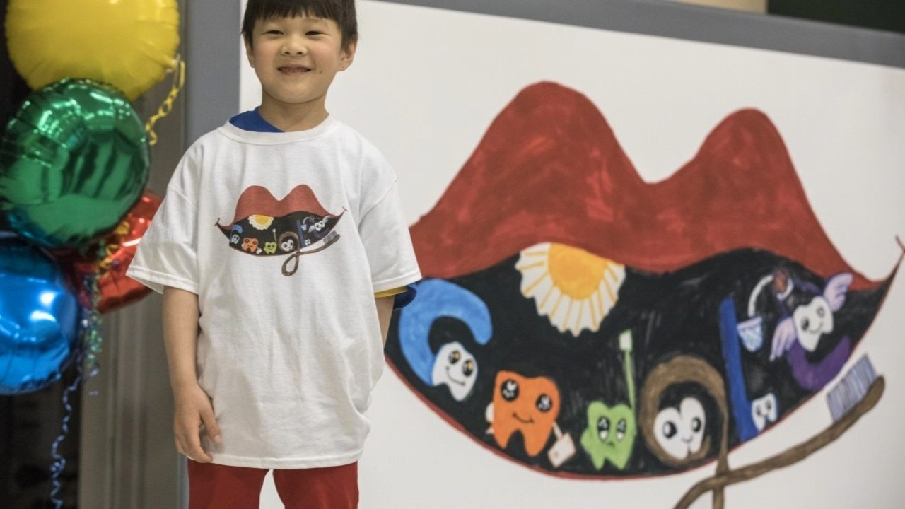Christopher Zhong-Yao stands in front of his doodle. (Photo courtesy Google).