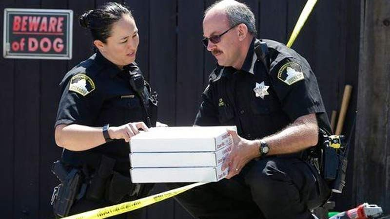 Deputies from the Sacramento County Sheriff's crime scene investigation office, conference about boxes of evidence gathered from the home of murder suspect Joseph DeAngelo (AP Photo/Rich Pedroncelli).