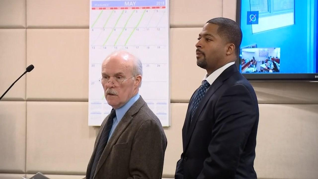 Aubre Dickson, right, in court Thursday. (KPTV)