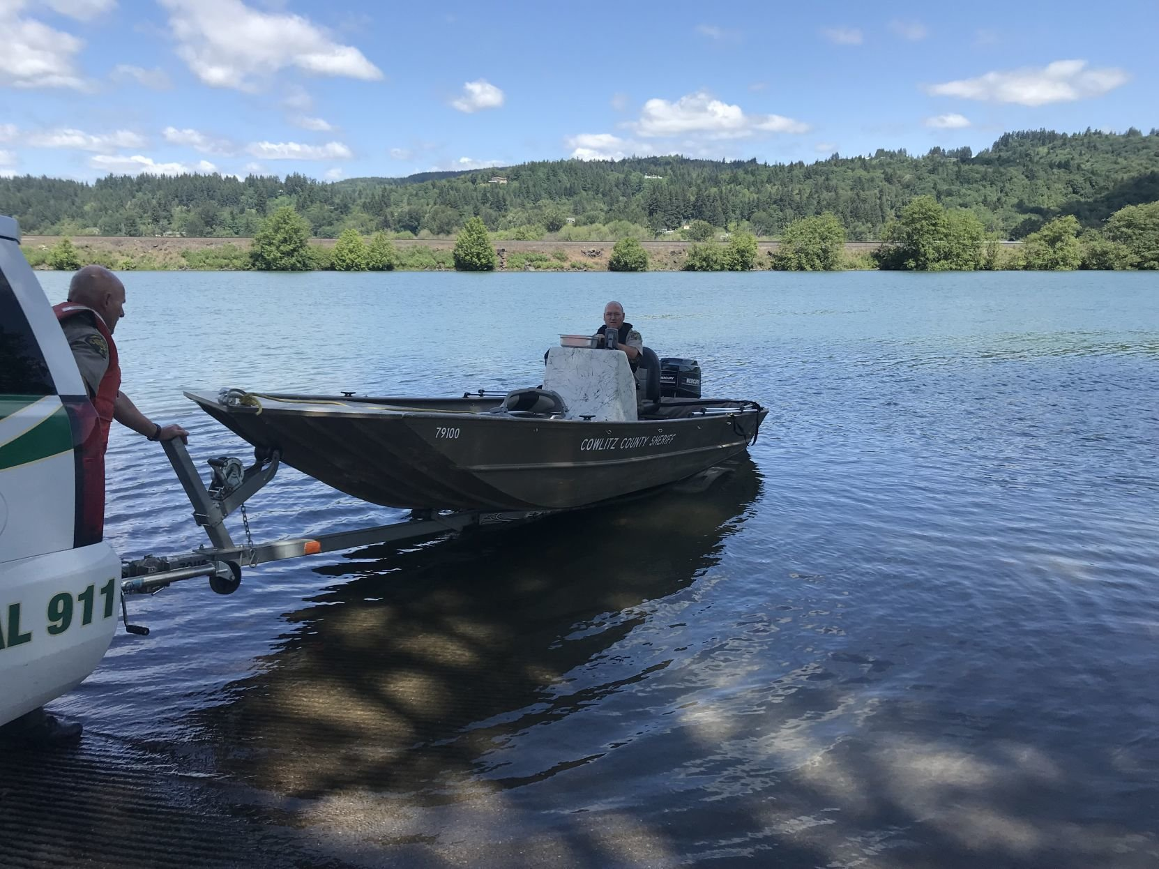 The sheriff's office towed the man's sunken boat to shore. (Photo: Cowlitz County Sheriff's Office).