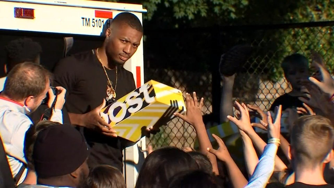 Damian Lillard handing out shoes at Irving Park in Portland on Monday. (KPTV)
