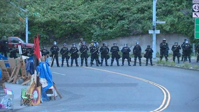 9 arrests as federal police clear entrance to Portland ICE building