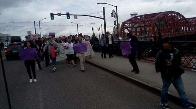 Students cross the Broadway Bridge.