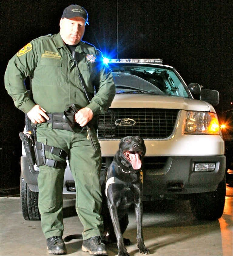 "Sr. Deputy Jerry Wollenschlaeger and his canine ""Yo"""