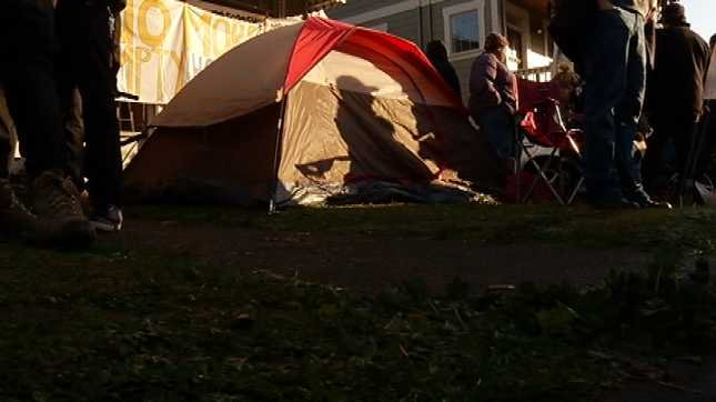 Two tents were set up in the yard of the home.