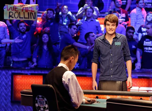 Jake Balsiger watches the flop after an all-in bet during the World Series of Poker Final Table event, Tuesday, Oct. 30, 2012, in Las Vegas. Balsiger won the hand and spiked his double. (AP Photo/Julie Jacobson)