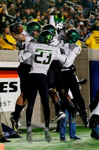 (AP Photo/Marcio Jose Sanchez). Oregon 's Colt Lyerla, at left with ball, celebrates his 14-yard touchdown reception with teammates during the second half of an NCAA college football game against California in Berkeley, Calif., Saturday, Nov. 10, 2012.