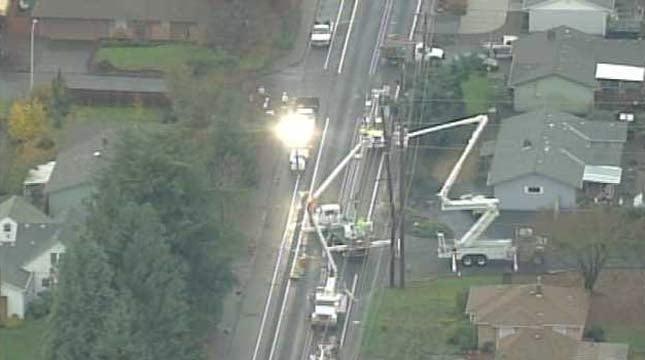 Crews work to repair power poles in Oregon City