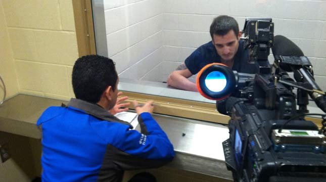 Fox 12 reporter Andrew Padula interviews Nigel Allen at the Clackamas County Jail