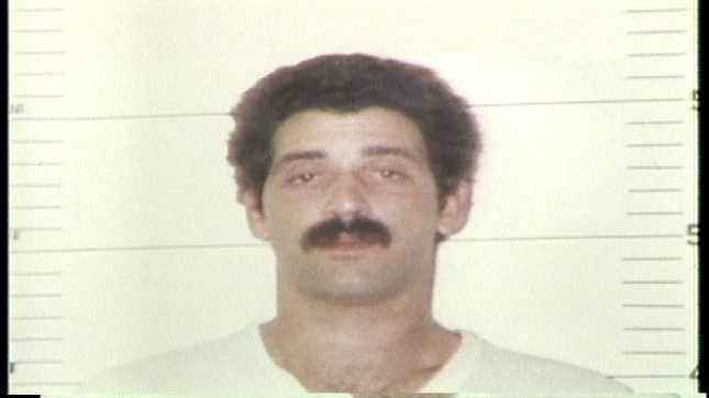 Scott Cox in a jail mug shot from the 1990s.