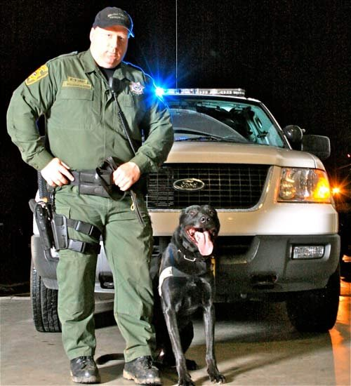 Sr. Deputy Jerry Wollenschlaeger and his K-9 named Yo