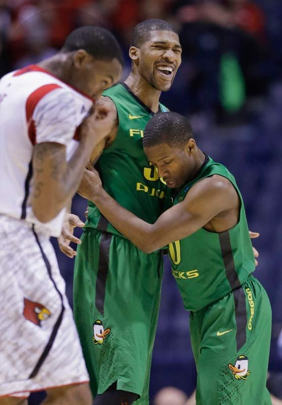 Oregon forward Carlos Emory and guard Johnathan Loyd, right, react during the first half of a regional semifinal against Louisville in the NCAA college basketball tournament, Friday, March 29, 2013, in Indianapolis. (AP Photo/Darron Cummings)