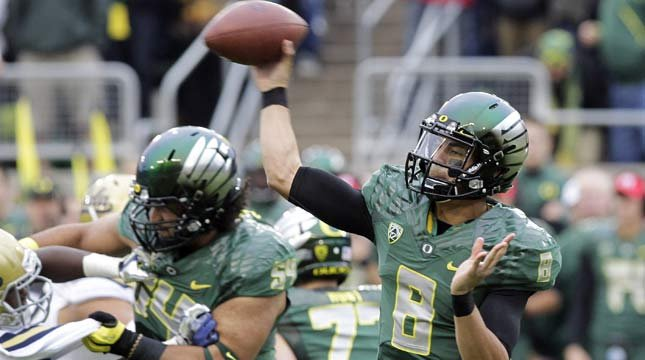 Oregon quarterback Marcus Mariota passes during the first half of an NCAA college football game against UCLA. (AP)