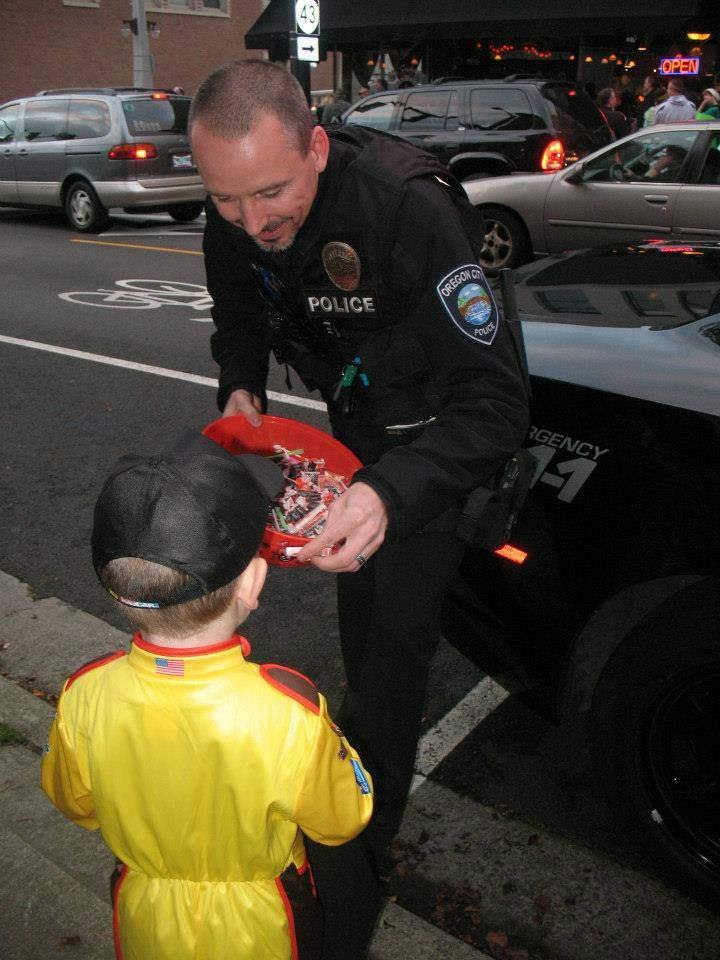 "Crystal Huck shared this photo with KPTV and wrote: ""This is my son Logan on Halloween he was sooo excited to go see the policeman who was handing out candy....RIP Officer Robert Libke, Thanks for making my son the happiest boy alive on Halloween!!"""