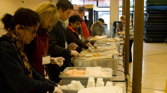 Volunteers serving up food at previous Thanksgiving