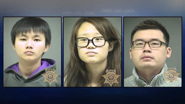 Khailee Soong, Mengzhao Tu, Xiaoling Cao. Washington County Jail booking photos