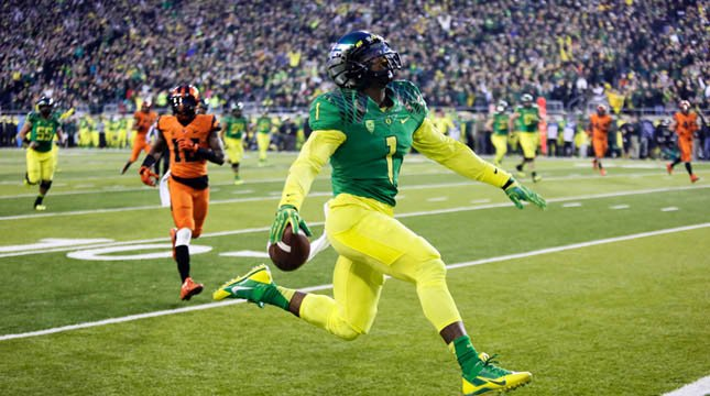 Oregon receiver Josh Huff leaps into the end zone after a reception and sideline run during the first half of the Civil War. (AP Photo/Don Ryan)