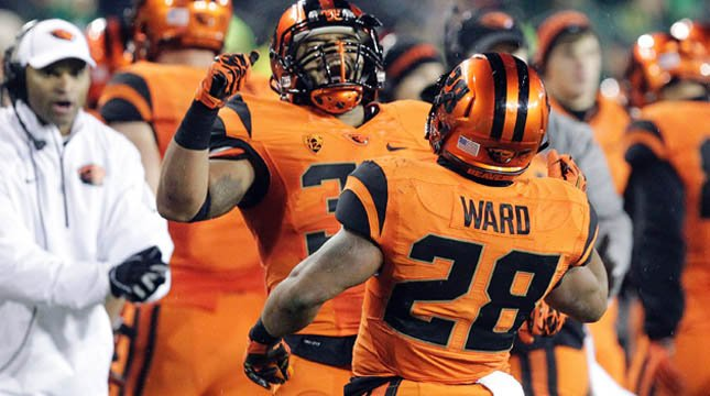 Oregon State running back Terron Ward, right, celebrates his touchdown with teammate Tyler Anderson. (AP Photo/Don Ryan)