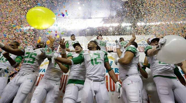 Oregon players celebrate the team's win over Texas in the Valero Alamo Bowl Monday. Oregon won 30-7. (AP Photo/Eric Gay)