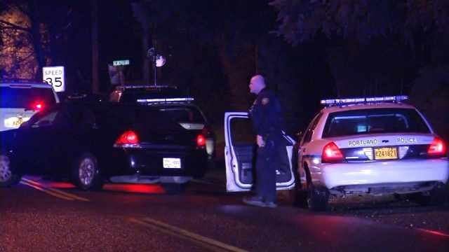 Portland police searched a southwest Portland neighborhood for the shooting suspect.