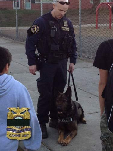 Officer Jeff Dorn and his fallen K-9 partner Mick