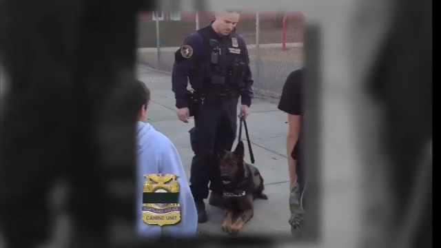 Officer Jeff Dorn and his fallen K-9 partner Mick