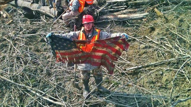 SSgt. Michael Cohan found this tattered American flag in the debris of the Washington mudslide. (Photo: Washington National Guard)