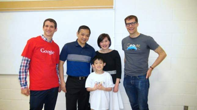 Matthew Huang Lei with his parents and Google workers.