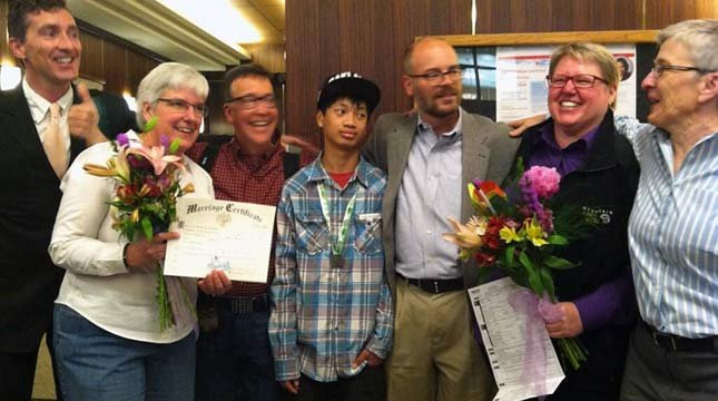 Couples celebrate the legalization of gay marriage in Oregon.