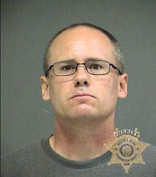 Bradley Robinett, booking photo