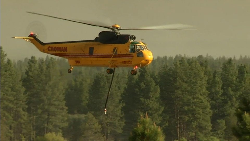 11 helicopters are helping fight the Two Bulls Fire from above