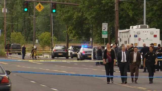 A Portland police officer shot a man to death after he attacked police with a crowbar on the Springwater Corridor on Tuesday.
