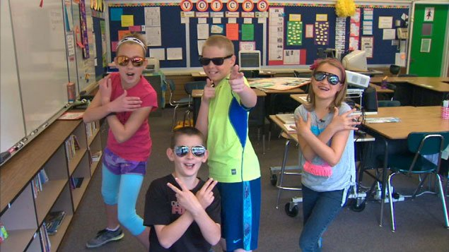 Stella, Huck, Nick, and Abby wrote a rap about sunscreen to educate their classmates