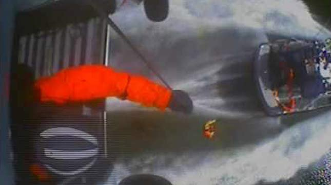 Image from Coast Guard rescue effort to save people who went into the Columbia River Bar after their boat capsized.